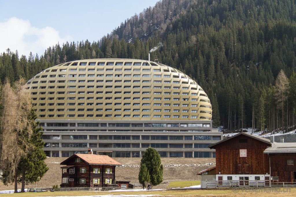 Golden facade of InterContinental hotel Davos amidst alpine landscape