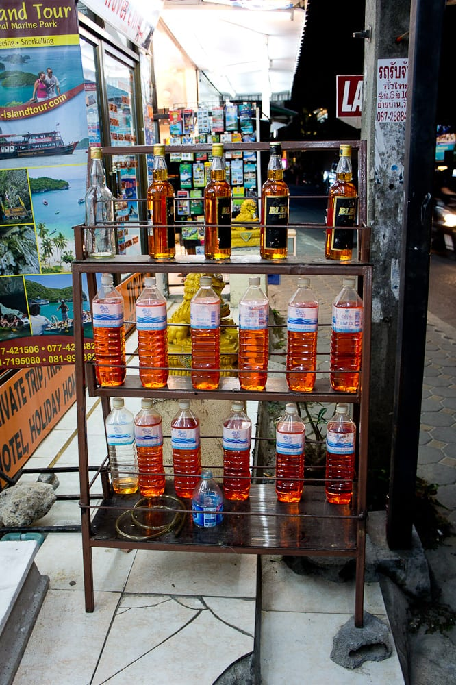 Whiskey bottles filled with fuel - fueling up, Thai edition…