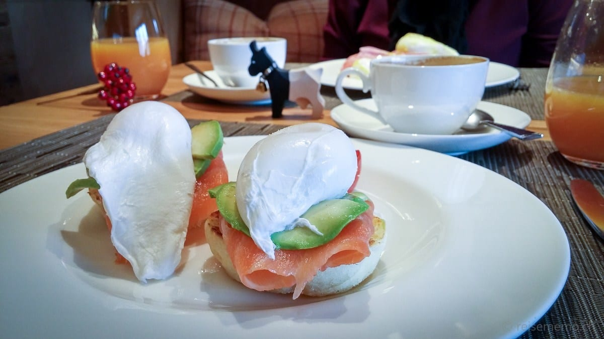 Poached egg on avocado and salmon for breakfast