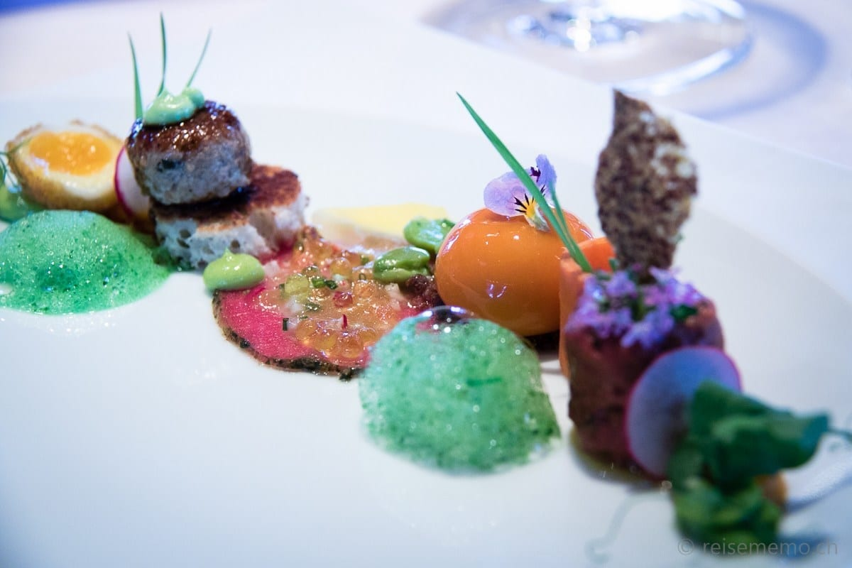 Plate on beef with carrots, radish, watercress and quail egg