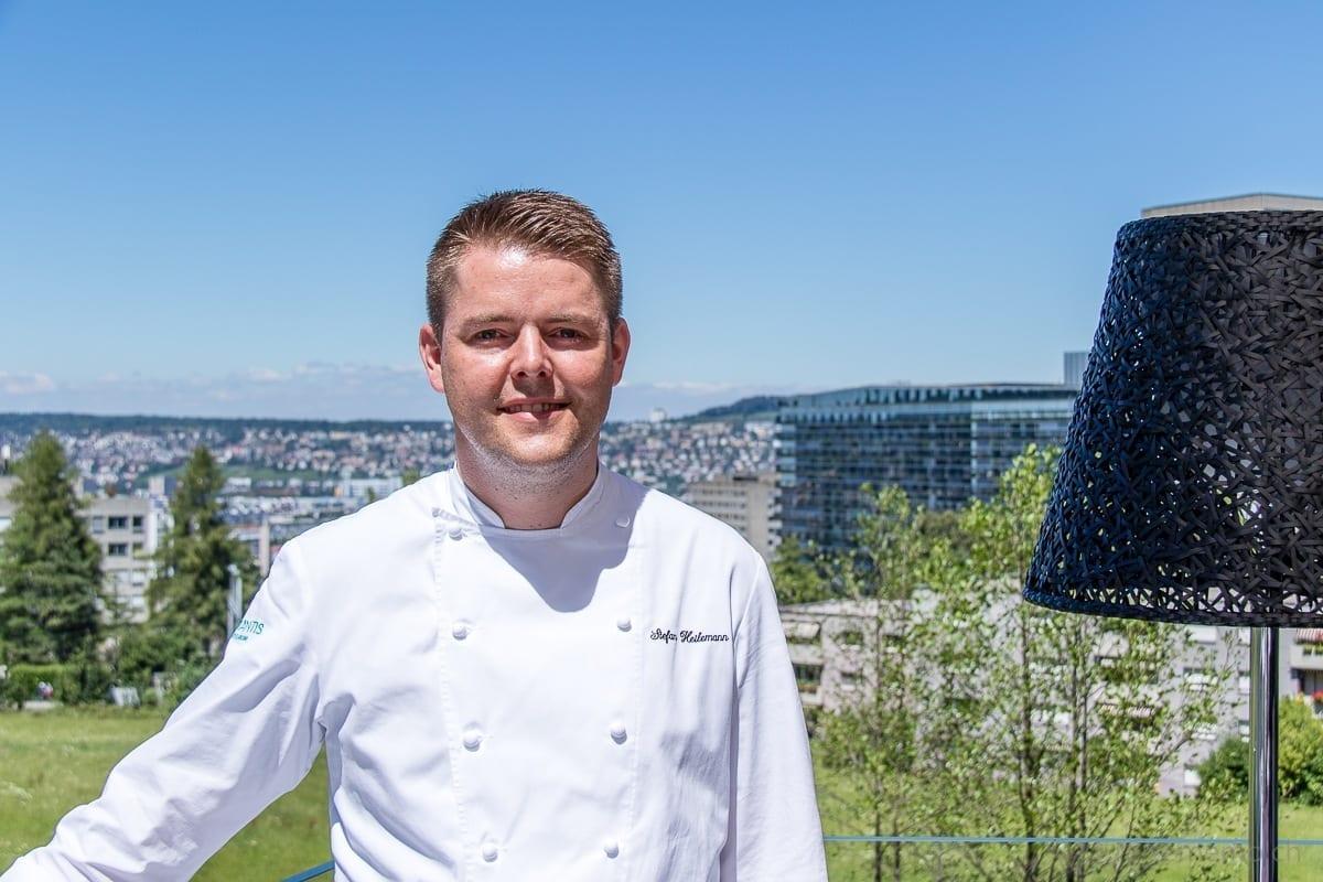 Executive Chef Stefan Heilemann with Zurich in the background