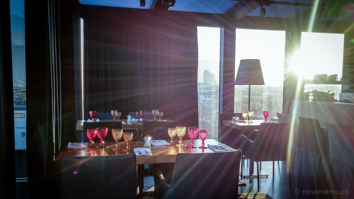 Breakfast table lit by morning sun
