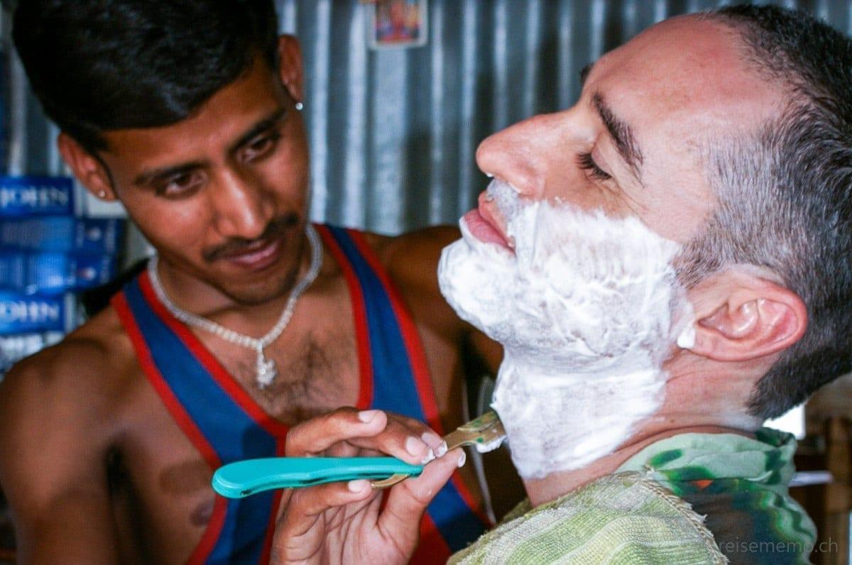 Walter Schaerer receiving a wet shave