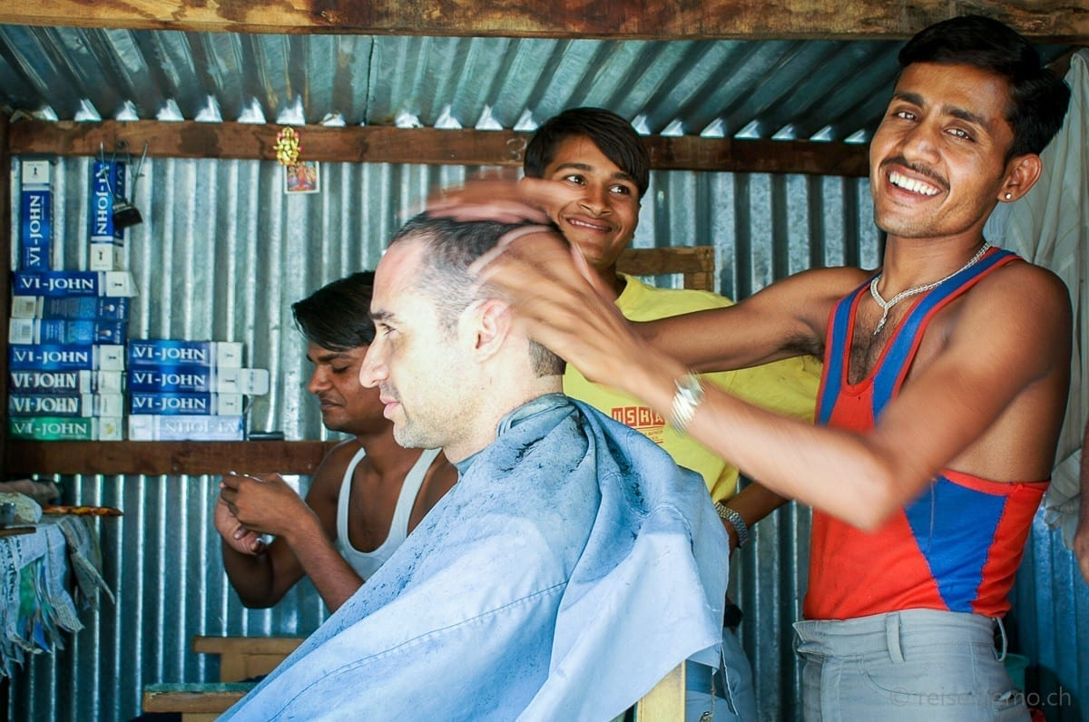 Coiffeur giving head and neck massage to Walter Schaerer