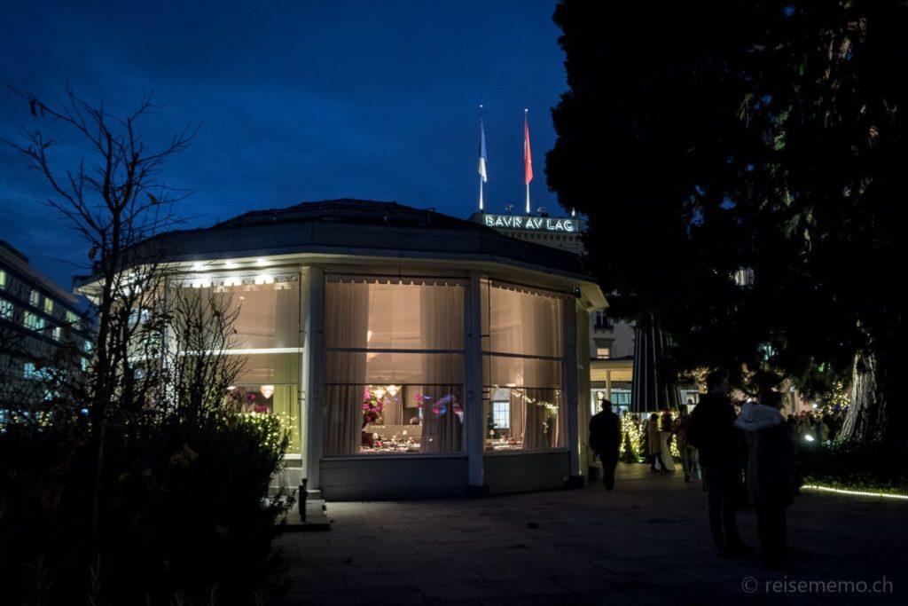 """Sternerestaurant """"Pavillon"""" und Leuchtschrift des Baur au Lac"""