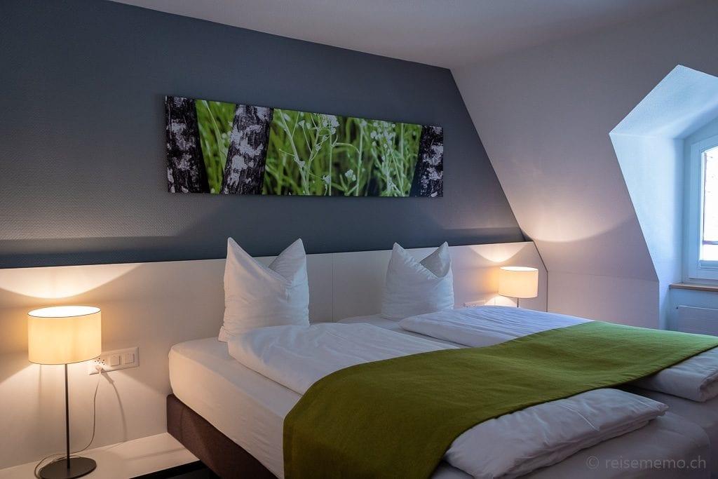 Bett der Suite im Hotel Vitznauerhof