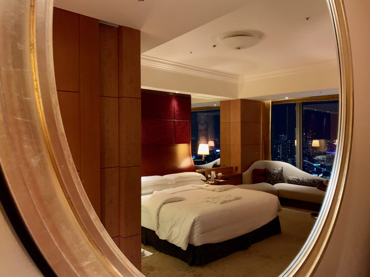 View of the bed in Shangri-La through a mirror