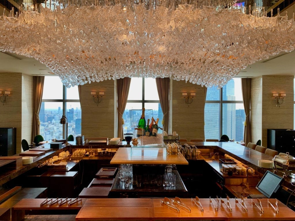 The lobby bar covered by a chandelier made of crystalline ginkgo leaves.