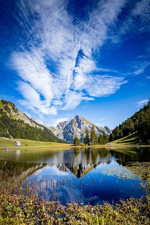 Gräppelensee und spiegelnder Wildhuser Schafberg im Toggenburg | Reisememo Bergseen Wanderung