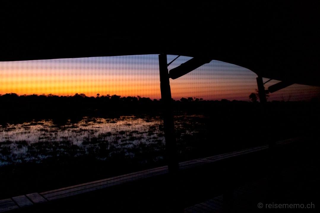 Sonnenaufgang vor dem Zelt des Little Mombo Camps